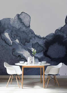 Add drama to your dining room spaces with this sophisticated wallpaper design. This watercolor wall mural brings luxurious navy tones into your home with style and elegance. Pair with gold finishes for a truly opulent feel.