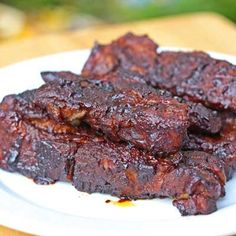 Saucy Country-Style Oven Ribs - This recipe uses boneless country-style ribs and boils then bakes them. I added a thick layer of minced garlic on one side of the ribs on top of the bbq sauce. These ribs were delicious! Ribs In Oven, Ribs On Grill, Barbecue Ribs, Barbecue Sauce, Bbq Sauces, Pork Recipes, Grilling Recipes, Cooking Recipes, Smoker Recipes