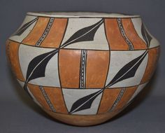 "Native American Acoma Pottery Jar 284. Description: 1960's poly chrome checker board design signed Lucy M Lewis, 6"" x 8"". Condition: Excellent overall for the age of the piece. Lucy Lewis is regarded"