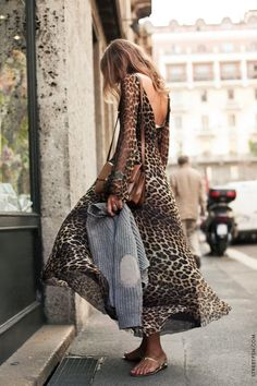 """""""Aurora Sansone's Unique Style"""" -- Fashion Editor and Stylist at Vogue Nippon, Aurora Sansone seems to be using a sidewalk grate to cool off in her animal print dress. Click through for more photos of her """"her unique Italian style...chic and romantic but also bold and eccentric."""" Also see her with the grey sweater (in her hand) on over the dress here: http://stylelovely.com/mydailystyle/2013/02/the-fashion-pack-aurora-sansone"""