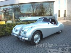 """Jaguar XK 120 Alloy 1950 for sale - Difficult to imagine nowadays that Jaguar founder and designer boss, William Lyons, was not entirely sure about his creation when he put a wood-framed open 2-seater bodied with aluminium panels, which was named XK 120, on display at the 1948 London Motorshow.  However, the roadster caused such a sensation that Lyons immediately decided to put this prototype into production. The \""""120\"""" in the name referred to the aluminium car's 120 mph (193 km/h) top…"""