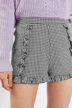 Soften your day-to-day look in these pretty gingham shorts in a monochrome colourway. We love the ruffle detail to the front panels and hem. Team with a crisp white shirt for a chic finish. #Topshop