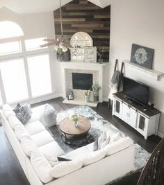 You have to see this #farmhouse living room decor idea with modern furniture and rustic accents. Love it! #RusticDecor #HomeDecorIdeas