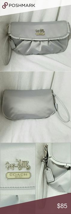 "COACH Silver Gray Pleated Flap Ribbon Wristlet Brand: Coach  Item: *This Listing is for a Very Beautiful, Unique & Rare Wristlet Small Bag *Exterior is a Soft Sateen that the bags are usually the interior lining *Flap Over, Snap Closure Pleated Wristlet with Pleated Ribbon Running all Along the Closure Flap *Interior Has One Larger than Average Open Pocket (Coach lovers will understand!) *Horse & Carriage on Flap with plaque of Coach Est 1941 *Measures 9""w x 5.5""h *Excellent, excellent…"