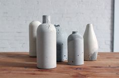 Use Old Bottles to Make Chic Concrete Vases - using plastic or glass bottles…
