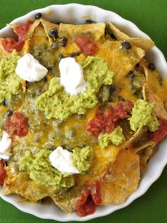 My daughter loves to feed herself and making sure each bite has a little of everything is best in the form of a nacho. Easy Snack for Kids: Healthier Nachos - Weelicious Recipe Video by weelicious Appetizer Recipes, Snack Recipes, Cooking Recipes, Epicurious Recipes, Healthy Recipes, Party Appetizers, Party Recipes, Healthy Foods, Easy Family Meals