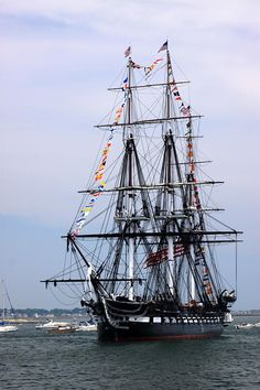 USS Constitution - Commissioned be George Washington. It is the oldest commissioned war ship still afloat, nicknamed Old Ironsides during the War of 1812, because British cannonballs would just bounce of the sides of it.