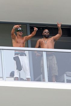 Shemar Moore Photos Photos - Shemar Moore waves and poses for fans and photographers from his balcony overlooking the beach in Miami.  - Shemar Moore Waves to Fans from His Balcony