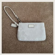 """Coach Signature Wristlet White White Coach signature wristlet. Measures 4""""x6"""". Still in excellent brand new condition with no signs of wear. Only used twice. Purchased a few years ago from Macy's. Also listed on Ⓜ️ercari. Coach Bags Clutches & Wristlets"""
