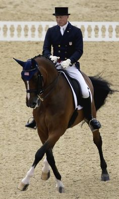 Jan Ebeling, of the United States, rides Rafalca in the equestrian dressage competition at the 2012 Summer Olympics, Thursday, Aug. 2, 2012, in London. Rafalca is co-owned by Ann Romney, the wife of U.S. Republican presidential candidate Mitt Romney. (AP Photo/David