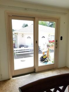 Gliding French door updates a failing vinyl slider and lightens up the kitchen space.