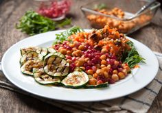 This vibrant warm buckwheat & pomegranate salad is topped with crispy harissa chickpeas and griddled courgettes.