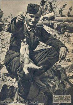 Nina the bunker cat of the 20th Waffen SS Grenadier division Narva, Estonia, circa 1944.