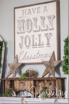 Have a Holly Jolly Christmas sign with boxwood wreaths on mantel