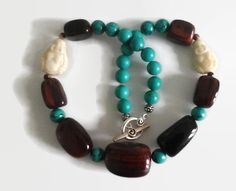 Unusual and unique dark brown and blue necklace with vintage bone buddhas