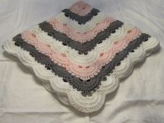 The perfect dainty Virus Pattern Baby Blanket. This is my favorite of all the blankets i ever made. Light weight and elegant, just the blanket for any little girl.  Blanket measures; 33 x 33  Made with Baby Bee 60% Acrylic and 40% Polyamide Sweet Delight yarn White, Pink and Grey