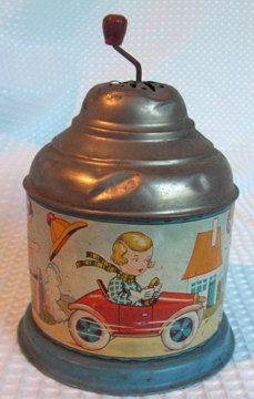 1930s German tin lithograph crank music box. $39,99, via Etsy.