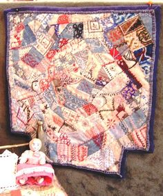 My favorite to date, this crazy quilt is done in vintage blues with red and white over-embroidery. Sized for a double 1:12 inch scale bed w...