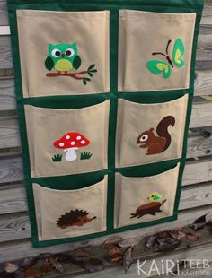 Organizer has 6 pockets and forest inspired pictures. Each picture is made of felt pieces and sewn on pocket material. Pockets are made of cotton fabric and base material is polyester. You can store books or toys in pockets. Make it fun for kids to clean up their own room! MEASUREMENTS (also on picture) Width 23 = 58cm Heigth 35 = 88cm Pocket size 10 x 10 = 25 x 25cm Distance between hanging loops 16 = 40cm Length of loop 3 = 8cm Organizer has 2 loops for hanging. ...