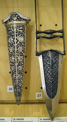 Indian katar (push dagger) and metal sheath, both intricately carved.