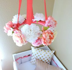 What an easy way to create the perfect flower nursery mobile with faux flowers from the craft store - Coral, Gold and White Nursery