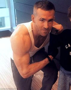 Buff: Ryan Reynolds showed off his impressive biceps when he posted this post-work out snap to Twitter on Monday
