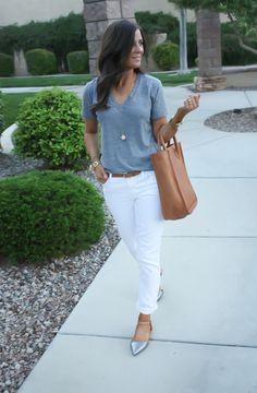 Navy top, white jeans, bow statement necklace, gold bracelets ...