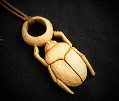 Hand carved scarab in cherry wood