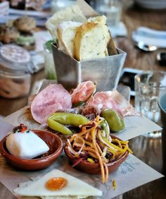 #Bali Cured Meats (I45k/pax) at @JamiesItalianBali Prosciutto di Parma fennel salami mortadella & bresaola served on a plank with mini mozzarella aged pecorino & chillijam pickles olives & rainbow slaw.