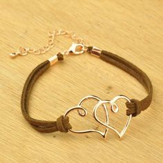FASHION-BRACELET-FAUX-SUEDE-CORD-WITH-ROSE-GOLD-COL-DOUBLE-HEARTS-WHTE-or-BRWN