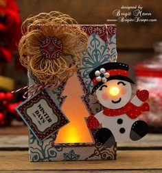 "Brigit's Scraps ""Where Scraps Become Treasures""  An adorable Snowman Tealight With Gift bag is a perfect gift!  Using HOME FOR THE HOLIDAYS KIT & CHRISTMAS CUDDLY FRIENDS COLLECTION, Brigit combined them into this glowing delight!  A tealight is used for his nose!  Check out her site to see how she did it!"