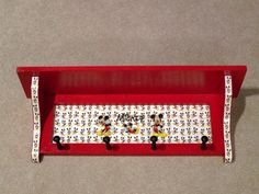 Red Mickey Mouse shelf with pegs. Buy or DIY. #Mickey #DisneyDecor