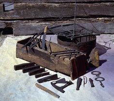 This is a set of tools which belonged to an Iron Age Viking craftsman. They apparently went overboard and were lost while he was trying to cross lake Mästermyr on the island of Gotland. In 1936 the wooden chest containing all the tools was found at the bottom of the former lake, which had turned into a bog over the centuries. This man had quite a collection of axes, hammers, tongs, punches, plate shears, saw blades, files, rasps, drills, chisels, knives, awls and whetstones among the 200…
