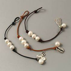 This item is unavailable women pearl leather bracelet,leather pearl bracelet,white pearl bracelet,leather bracelet,silver cha Leather Pearl Bracelet, Silver Charm Bracelet, Leather Jewelry, Silver Charms, Silver Bracelets, Beaded Bracelets, Leather Cord, Leather Bracelets, Couple Bracelets