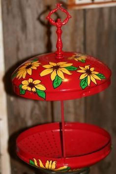 DIY Bird Feeder! - made with old mismatched metal lids and dowel rod... spray paint find a lamp finial to fit add decals or decoupage! (other ideas various items - molds bundt pans etc - drill holes & use chains. can leave unpainted or age it)