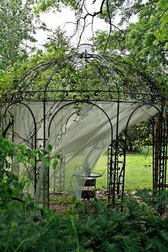 I love the idea of a vine covered gazebo. And I love this round one.