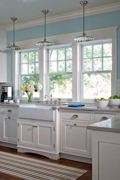 Country Kitchen with European Cabinets, Farmhouse sink, Subway Tile, L-shaped, Flat panel cabinets, Complex marble counters