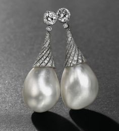 Pearl Ear Pendants  of The Romanovs ~  266.1 and 216.37 grans - diamond spirals - presented by one of Russian Emperors to his wife as a gift of love - Alexandra Feodorovna was the last Empress to wear them.The pearls were sold in 1910s. Their current owner  put them into diamond spirals. Christie's estimated price - $2,5 mlllion