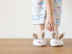 DIY Bunny Slippers | Lovely Indeed - Materials: plain pair of slippers (these came from Marshalls for about $7!), pink and white felt, lace or decorative fabric, scissors, glue gun. - Make Time: 20 Minutes