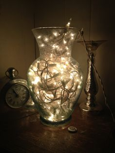 Easy homemade lamp. Spray glue, glitter, then stuffed with white Christmas  lights.