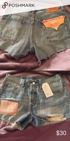 Levi Shorts DID NOT make these this is how they were bought ! New with tags , perfect condition rips/frays are how they were when I bought them. Size is a 26.Not trading ! 💙 Levi's Shorts