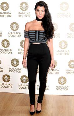 Kourtney Kardashian in an Erdem crop top, high-waisted black pants and choker