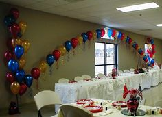35ft Pearl Balloon Arch banked with large Balloon Floor Arrangements for a Military Wedding Reception