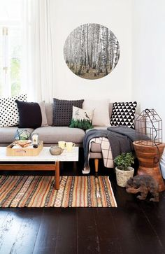 Layer this geometric weave over a dark surface to let the colors really pop. We love pairing with walnut wood and varying textile tones like dove gray and charcoal gray. Add green plants to your living area to bring out the earthy vibe of this rug.
