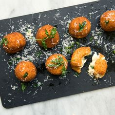 Arancini, the crispy-on-the-outside and cheesy-on-the-inside fried rice ball, is the ultimate cocktail hour snack. Get Michael Symon's recipe from Food & Wine,