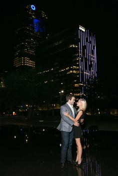 Nighttime outdoor engagement photo in Downtown Dallas - Photos by The Mamones