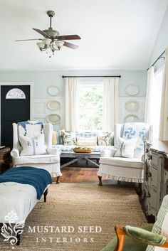 Love the wingback slipcovered chairs.