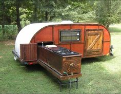 Teardrop Trailer with pull out kitchen - Imagine this with locking drawers under the whole thing that pull out from either side - Killer!
