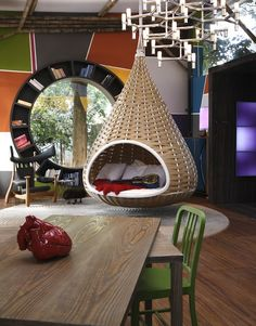 As if the hanging bed wasn't cool enough, check out the round window with the circular bookshelf.  I want it!