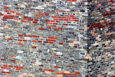 grey and red | An old brick wall in downtown London.